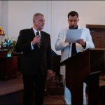 Samuel Samaan translates for his father's ordination